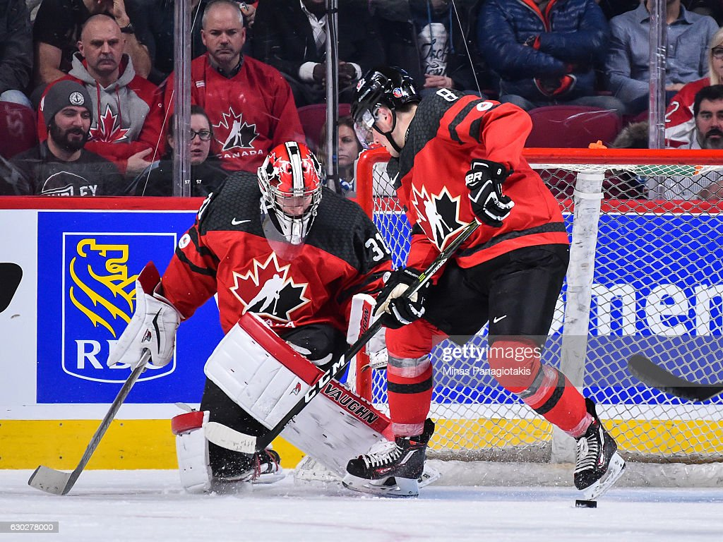 Goaltender Carter Hart #31 of Team Canada and teammate Dante Fabbro #8 lose sight of the puck during the IIHF exhibition game against Team Finland at the Bell Centre on December 19, 2016 in Montreal, Quebec, Canada. Team Canada defeated Team Finland 5-0.