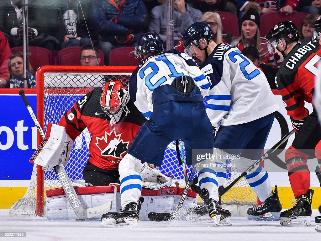 Goaltender Carter Hart #31 of Team Canada makes a stick save in front of Joona Luoto of Team Finland #21 during the IIHF exhibition game at the Bell Centre on December 19, 2016 in Montreal, Quebec, Canada. Team Canada defeated Team Finland 5-0.