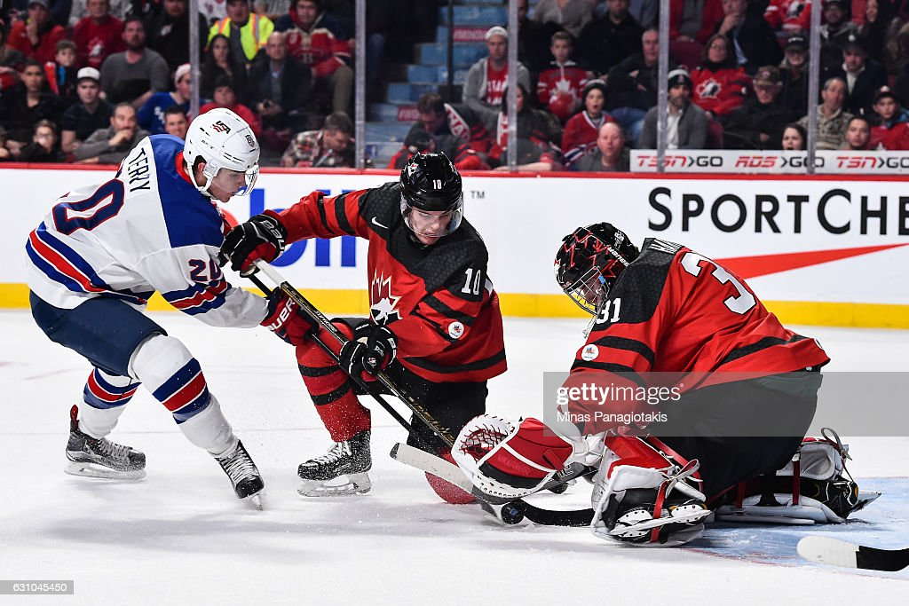 Goaltender Carter Hart #31 of Team Canada tries to cover the puck while teammate Kale Clague #10 defends against Troy Terry #20 of Team United States during the 2017 IIHF World Junior Championship gold medal game at the Bell Centre on January 5, 2017 in Montreal, Quebec, Canada.