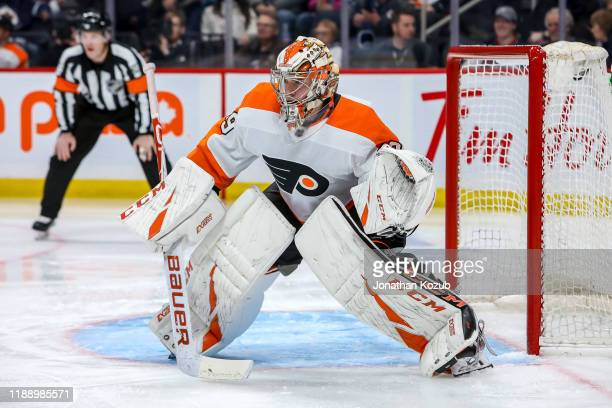 Goaltender Carter Hart of the Philadelphia Flyers guards the net during third period action against the Winnipeg Jets at the Bell MTS Place on...