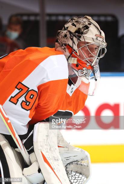 Goaltender Carter Hart of the Philadelphia Flyers looks on during warm ups before the exhibition game against the Pittsburgh Penguins prior to the...