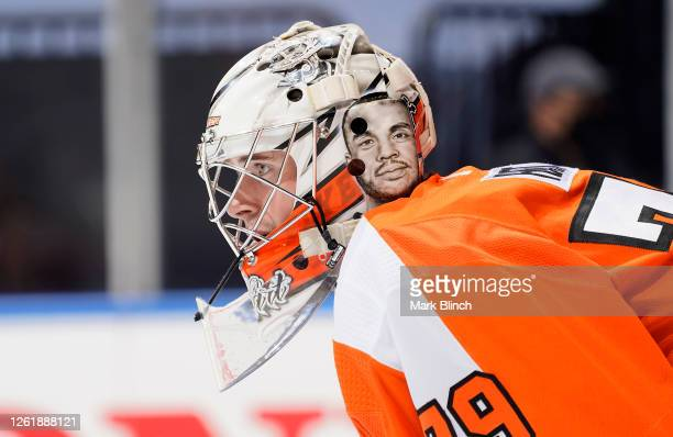 Goaltender Carter Hart of the Philadelphia Flyers looks on during the second period of an exhibition game against the Pittsburgh Penguins prior to...