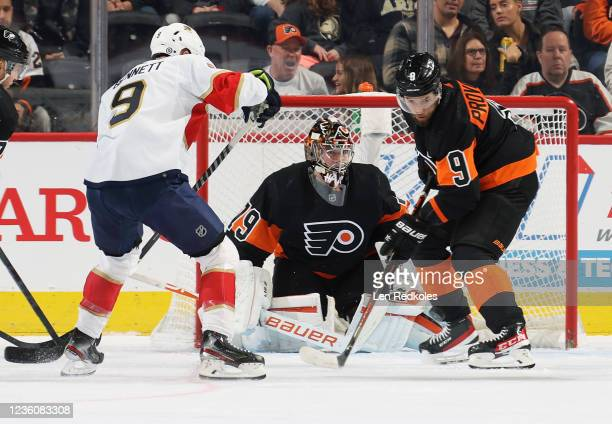 Goaltender Carter Hart of the Philadelphia Flyers protects his net as Ivan Provorov defends against Sam Bennett of the Florida Panthers at the Wells...