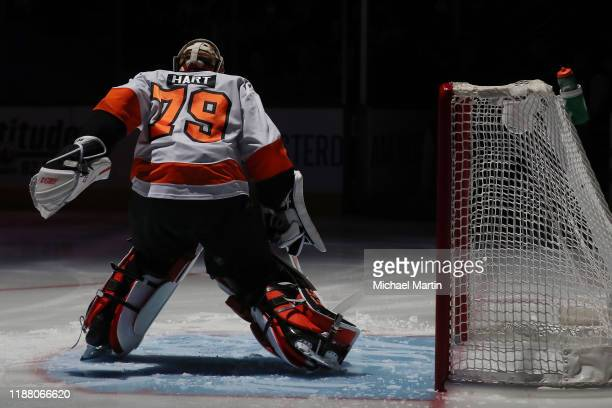 Goaltender Carter Hart of the Philadelphia Flyers skates in his crease prior to the game against the Colorado Avalanche at Pepsi Center on December...