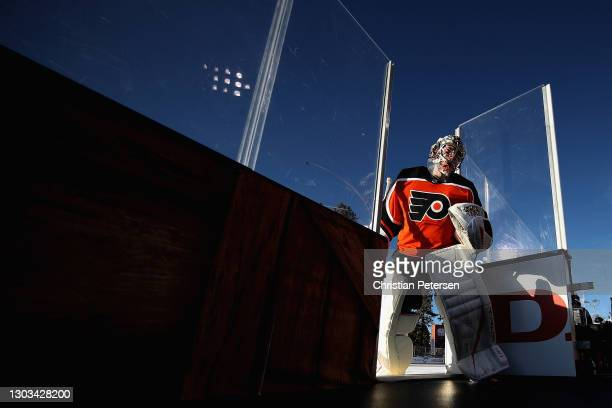 Goaltender Carter Hart of the Philadelphia Flyers steps off the ice during the 'NHL Outdoors At Lake Tahoe' against the Boston Bruins at the Edgewood...