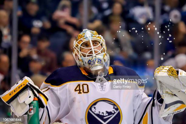 Goaltender Carter Hutton of the Buffalo Sabres looks on during a second period stoppage in play against the Winnipeg Jets at the Bell MTS Place on...