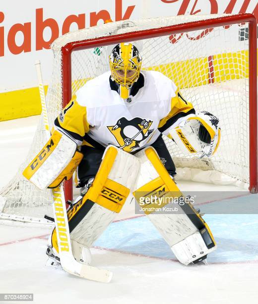 Goaltender Casey Desmith of the Pittsburgh Penguins guards the net during third period action against the Winnipeg Jets at the Bell MTS Place on...