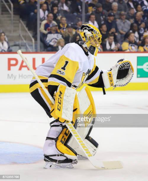Goaltender Casey Desmith of the Pittsburgh Penguins guards the net during second period action against the Winnipeg Jets at the Bell MTS Place on...