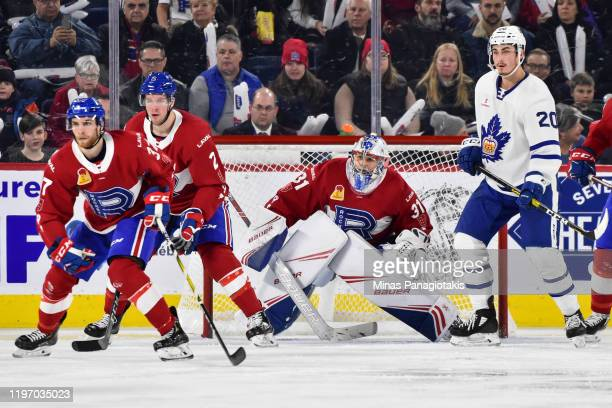 Goaltender Cayden Primeau of the Laval Rocket defends the net near Mason Marchment of the Toronto Marlies during the second period at Place Bell on...
