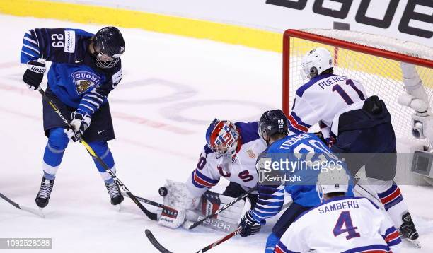 Goaltender Cayden Primeau of the United States makes a blocker save against Rasmus Kupari of Finland during a gold medal game at the IIHF World...