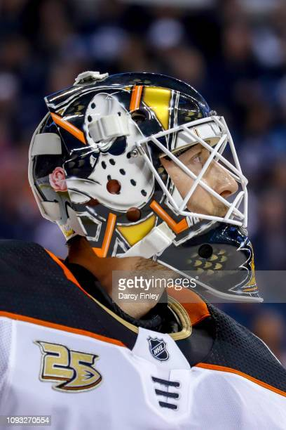 Goaltender Chad Johnson of the Anaheim Ducks looks on during a second period stoppage in play against the Winnipeg Jets at the Bell MTS Place on...