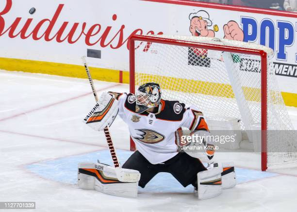 Goaltender Chad Johnson of the Anaheim Ducks redirects the puck wide of the net during second period action against the Winnipeg Jets at the Bell MTS...