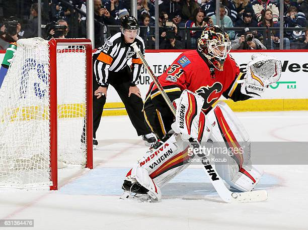 Goaltender Chad Johnson of the Calgary Flames guards the net during second period action against the Winnipeg Jets at the MTS Centre on January 9...