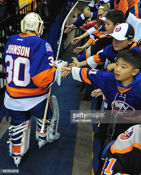 Goaltender Chad Johnson of the New York Islanders greets fans during the game against the Carolina Hurricanes at Nassau Veterans Memorial Coliseum on...