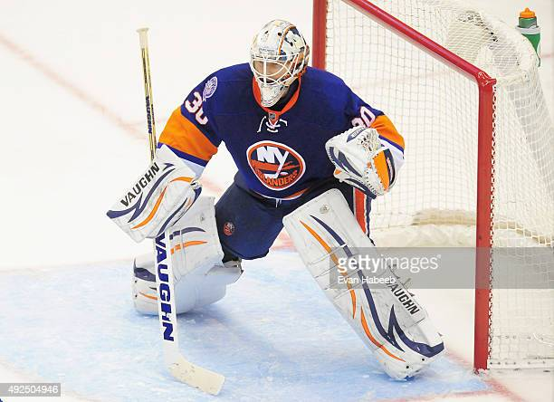 Goaltender Chad Johnson of the New York Islanders plays in the game against the Carolina Hurricanes at Nassau Veterans Memorial Coliseum on October...