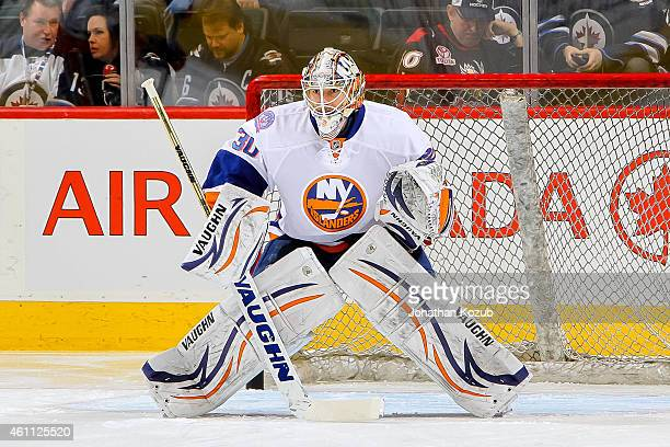 Goaltender Chad Johnson of the New York Islanders takes part in the pregame warm up prior to NHL action against the Winnipeg Jets on December 31 2014...