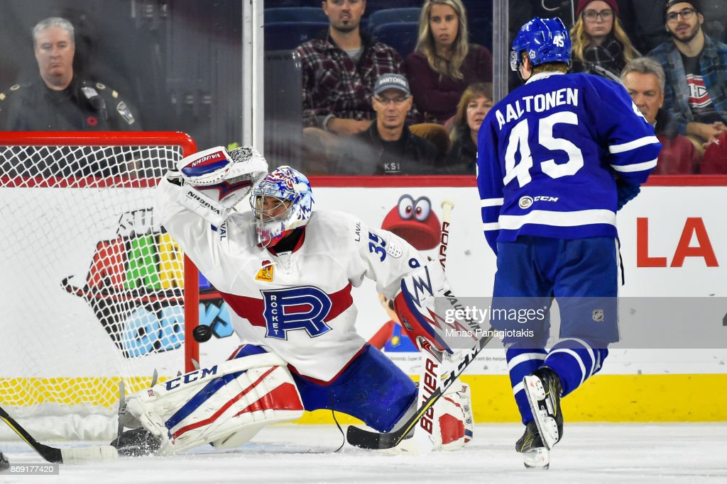 Goaltender Charlie Lindgren #35 of the Laval Rocket makes a save against the Toronto Marlies during the AHL game at Place Bell on November 1, 2017 in Laval, Quebec, Canada. The Toronto Marlies defeated the Laval Rocket 3-0.