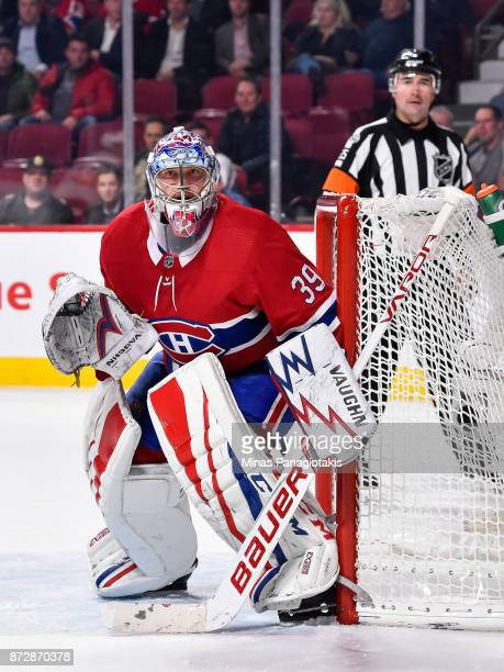 Goaltender Charlie Lindgren of the Montreal Canadiens hugs the goalpost as he protects the net against the Vegas Golden Knights during the NHL game...
