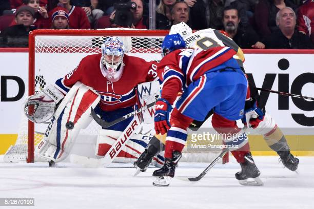 Goaltender Charlie Lindgren of the Montreal Canadiens protects his net as William Carrier of the Vegas Golden Knights takes a shot during the NHL...