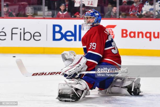Goaltender Charlie Lindgren of the Montreal Canadiens protects his net during the warmup against the New York Rangers prior to the NHL game at the...
