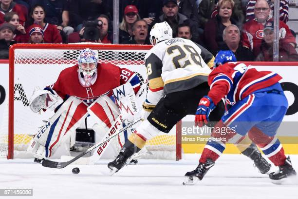 Goaltender Charlie Lindgren of the Montreal Canadiens remains focused as William Carrier of the Vegas Golden Knights skates in with the puck during...