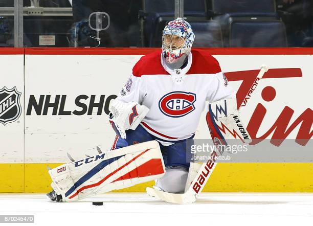 Goaltender Charlie Lindgren of the Montreal Canadiens takes part in the pregame warm up prior to NHL action against the Winnipeg Jets at the Bell MTS...
