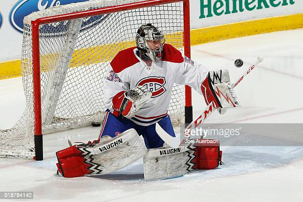 Goaltender Charlie Lindgren of the Montreal Canadiens warms up prior to the game against the Florida Panthers at the BBT Center on April 2 2016 in...