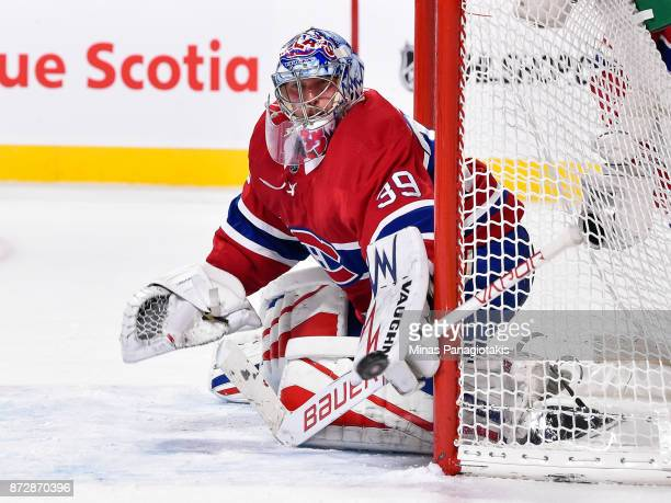 Goaltender Charlie Lindgren of the Montreal Canadiens watches the puck as he protects his net against the Vegas Golden Knights during the NHL game at...