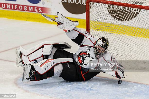 Goaltender Chase Marchand of the RouynNoranda Huskies falls to glove the puck during the QMJHL game against the BlainvilleBoisbriand Armada at the...