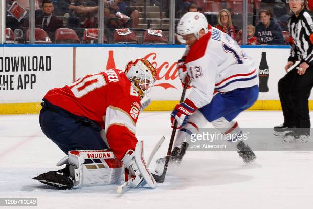 Goaltender Chris Driedger of the Florida Panthers stops a shot by Max Domi of the Montreal Canadiens during second period action at the BBT Center on...