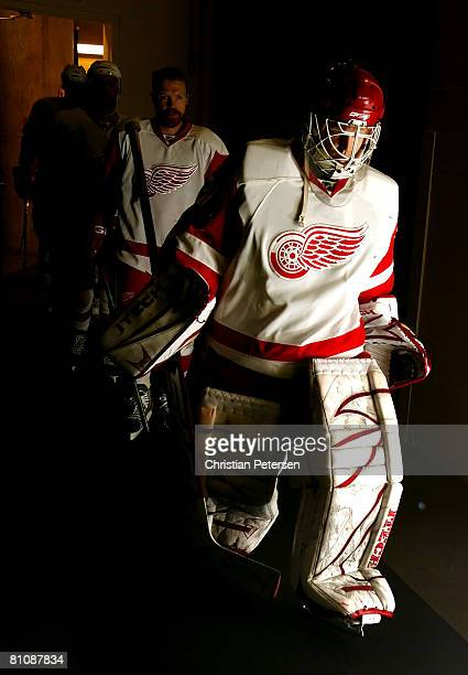 Goaltender Chris Osgood and Tomas Holmstrom of the Detroit Red Wings lead teammates out onto the ice for warm ups to game four of the Western...