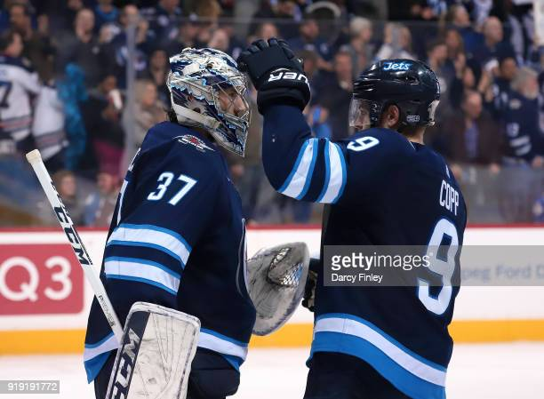 Goaltender Connor Hellebuyck and Andrew Copp of the Winnipeg Jets celebrate a 61 victory over the Colorado Avalanche at the Bell MTS Place on...