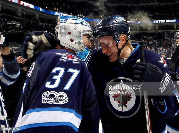 Goaltender Connor Hellebuyck and Patrik Laine of the Winnipeg Jets celebrate a 52 victory over the Dallas Stars at the MTS Centre on February 14 2017...