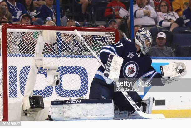 Goaltender Connor Hellebuyck of the Winnipeg Jets competes in the GEICO NHL Save Streak during 2018 GEICO NHL AllStar Skills Competition at Amalie...