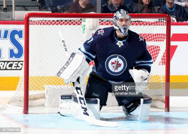 Goaltender Connor Hellebuyck of the Winnipeg Jets gets set in the crease prior to puck drop against the Washington Capitals at the Bell MTS Place on...