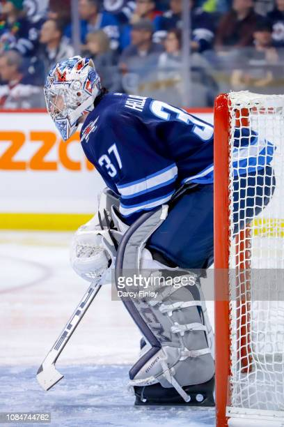Goaltender Connor Hellebuyck of the Winnipeg Jets guards the net during third period action against the Tampa Bay Lightning at the Bell MTS Place on...