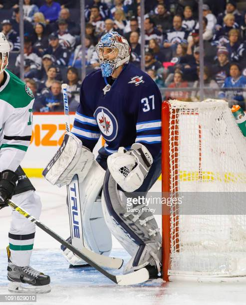 Goaltender Connor Hellebuyck of the Winnipeg Jets guards the net during third period action against the Dallas Stars at the Bell MTS Place on January...