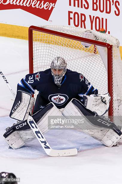 Goaltender Connor Hellebuyck of the Winnipeg Jets guards the net during first period action against the Arizona Coyotes at the MTS Centre on January...