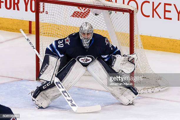 Goaltender Connor Hellebuyck of the Winnipeg Jets guards the net during third period action against the Dallas Stars at the MTS Centre on February 2...