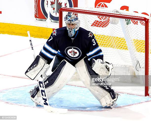 Goaltender Connor Hellebuyck of the Winnipeg Jets guards the net during third period action against the Carolina Hurricanes at the MTS Centre on...