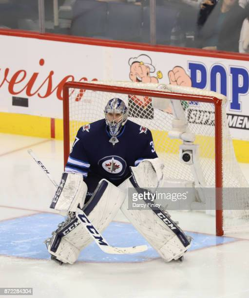 Goaltender Connor Hellebuyck of the Winnipeg Jets guards the net during third period action against the Montreal Canadiens at the Bell MTS Place on...