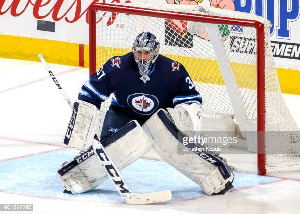 Goaltender Connor Hellebuyck of the Winnipeg Jets guards the net during third period action against the New York Islanders at the Bell MTS Place on...