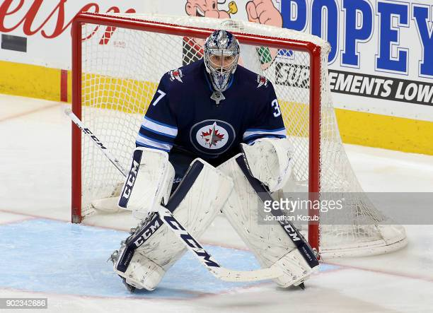 Goaltender Connor Hellebuyck of the Winnipeg Jets guards the net during third period action against the San Jose Sharks at the Bell MTS Place on...