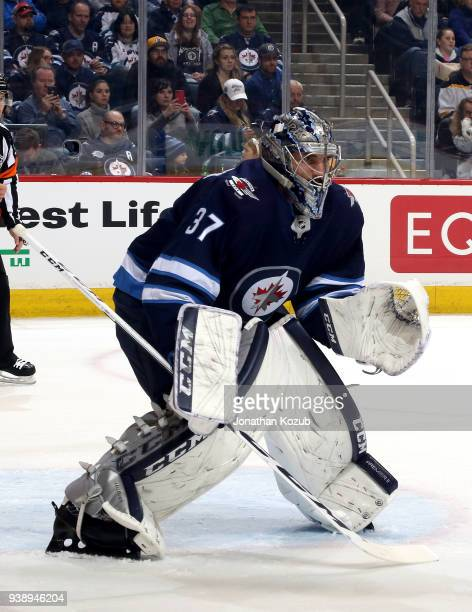 Goaltender Connor Hellebuyck of the Winnipeg Jets guards the net during first period action against the Boston Bruins at the Bell MTS Place on March...
