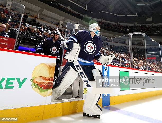 Goaltender Connor Hellebuyck of the Winnipeg Jets hits the ice prior to puck drop against the Florida Panthers at the MTS Centre on December 15 2016...