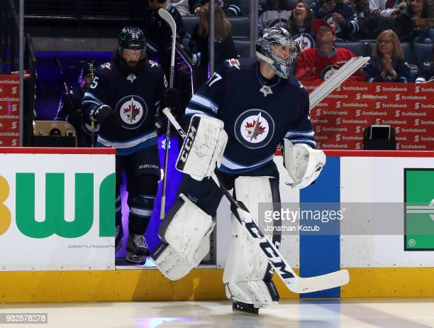 Goaltender Connor Hellebuyck of the Winnipeg Jets hits the ice prior to puck drop against the Chicago Blackhawks at the Bell MTS Place on March 15...