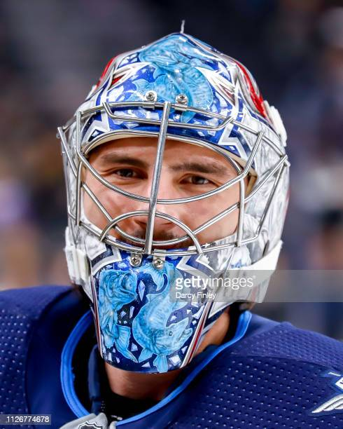 Goaltender Connor Hellebuyck of the Winnipeg Jets looks on during the pregame warm up prior to NHL action against the Vegas Golden Knights at TMobile...