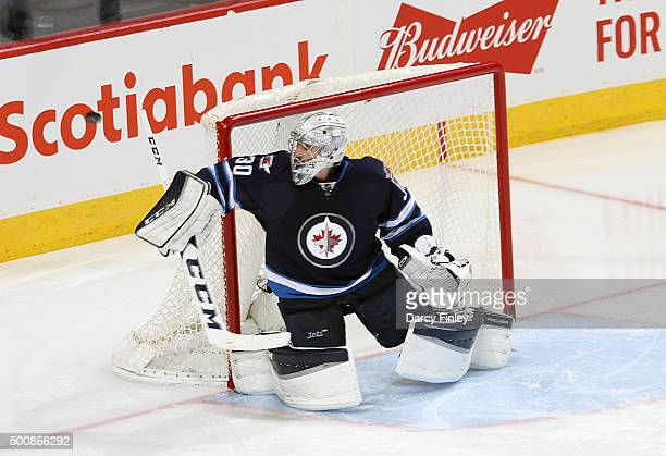 Goaltender Connor Hellebuyck of the Winnipeg Jets redirects the puck wide of the net during second period action against the Columbus Blue Jackets at...