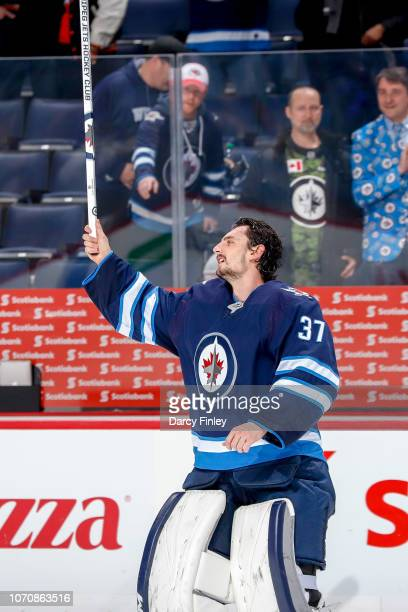 Goaltender Connor Hellebuyck of the Winnipeg Jets salutes the fans after receiving first star honours following a 71 victory over the Philadelphia...