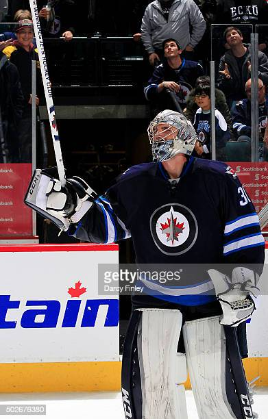 Goaltender Connor Hellebuyck of the Winnipeg Jets salutes the fans after recording his first career NHL shutout in a 10 victory over the Pittsburgh...